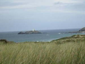 "Godrevy Lighthouse and ""the green sand dunes with the wild flowing grasses on them"""